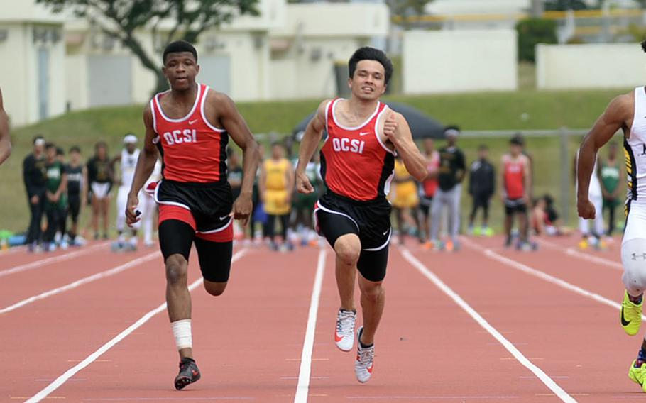 Nile C. Kinnick's Isaiah Brown, Okinawa Christian's Sam Calvin and Patrick Houston and Kadena's Eric McCarter head for the finish of the boys 100-meter dash during Friday's Mike Petty Memorial Track and Field Meet. McCarter won the 100 and the 200.