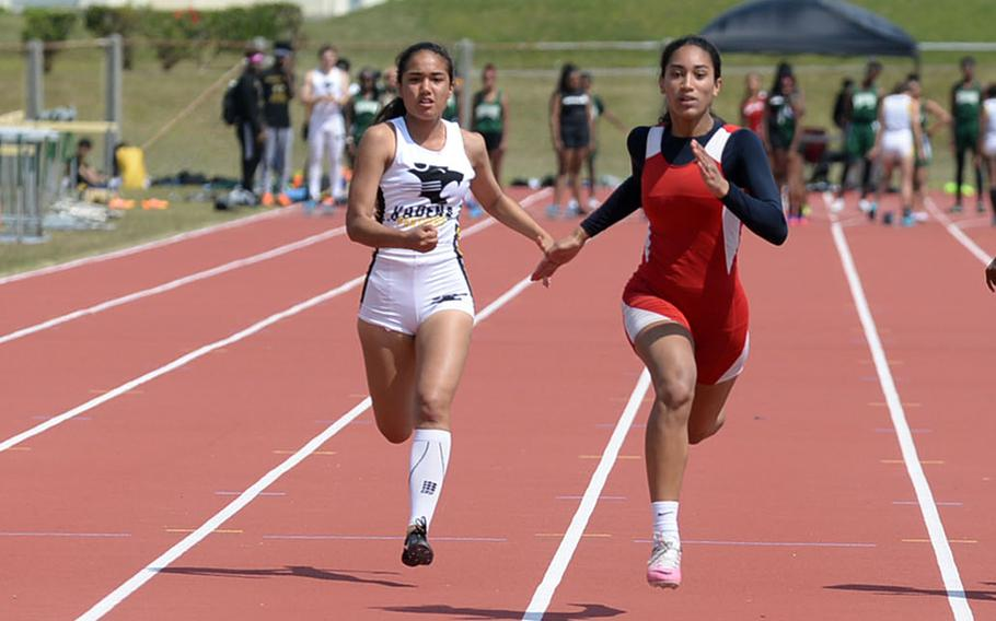 Kubasaki's Savannah Fermin, Kadena's Lexa Garcia, Nile C. Kinnick's Exotica Hall and Kubasaki's Nala Gardner sprint to the tape in the girls 100-meter dash during Friday's Mike Petty Memorial Track and Field Meet. Hall won the event.