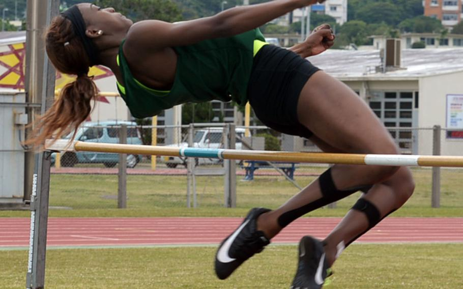 Kubasaki's Ja'Tavia Callier clears the bar at 1.55 meters during Friday's Mike Petty Memorial Track and Field Meet. She came in second in the high jump but won three other events.