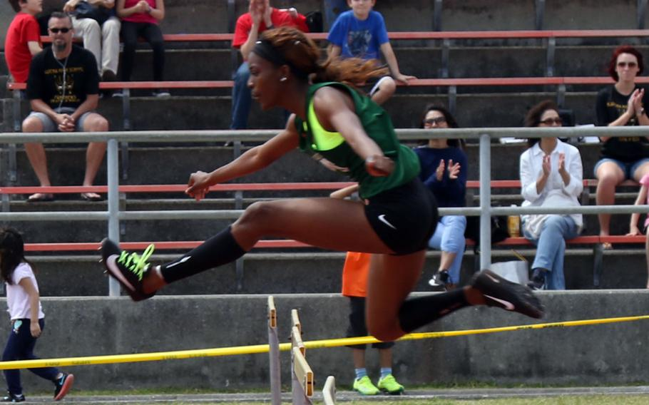 Kubasaki's Ja'Tavia Callier negotiates a hurdle en route to completing the 300-meter hurdles event in 46.81 seconds, .2 seconds hy of the Pacific record. Callier won three events and took second in another during Friday's Mike Petty Memorial Track and Field Meet.