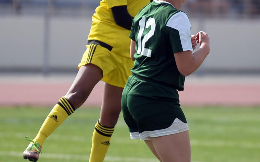 """Kadena's Korina """"Koko"""" Macato skies to head the ball over Kubasaki's Willow Lewis during Saturday's Okinawa girls soccer match. The Panthers won 3-0."""
