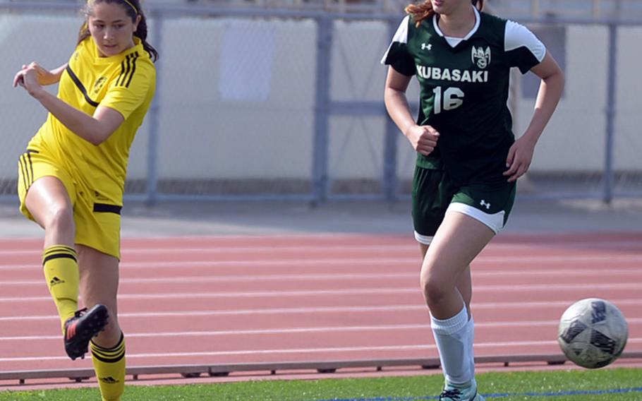 Kadena's Phoebe Bills sends a cross pass past Kubasaki's Abigail Robinson during Saturday's Okinawa girls soccer match. The Panthers won 3-0.