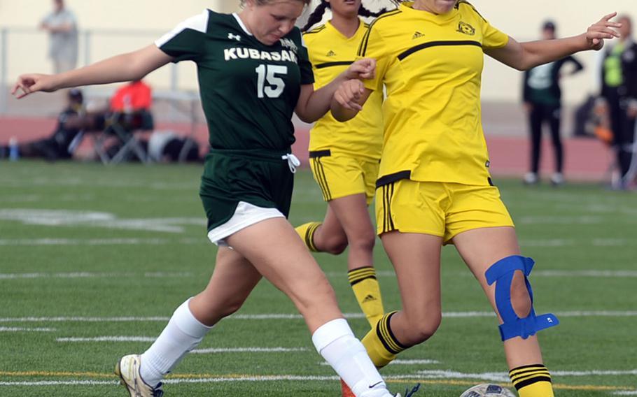 Kubasaki defender Hanna Ervasti and Kadena forward Megan Kirby chase the ball during Saturday's Okinawa girls soccer match. The Panthers won 3-0.