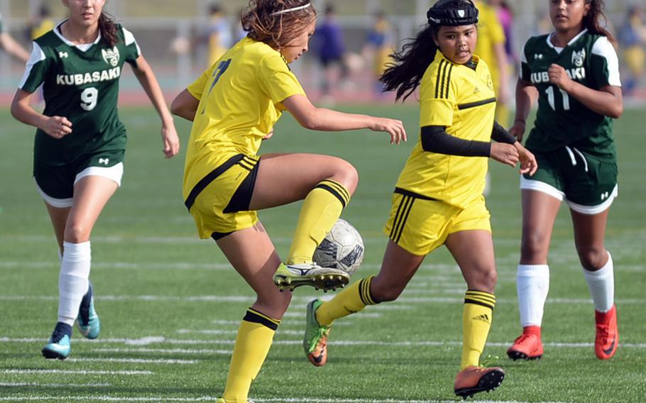 "Kadena's Adrianna Gomez tries to settle the ball in front of teammate Korina ""Koko"" Macato as Kubasaki defenders Natalie Mulherin and Chloe Ibarra move up during Saturday's Okinawa girls soccer match. The Panthers won 3-0."