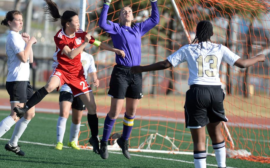 Humphreys goalkeeper Elayne Snyder leaps for a corner kick against Seoul Foreign during Wednesday's Korea Blue girls soccer match, won by the Crusaders 2-1.