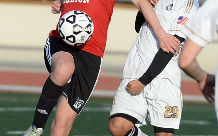 Seoul Foreign's Yoochan Joung plays the ball off his knee in front of Humphreys' Christian Saaveda during Wednesday's Korea Blue boys soccer match, won by the Crusaders 9-2.