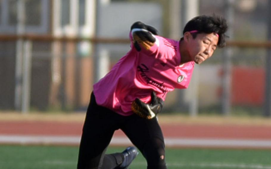 Looking every bit the baseball pitcher, Humphreys goalkeeper Jack Heo throws the ball against Seoul Foreign during Wednesday's Korea Blue boys soccer match, won by the Crusaders 9-2.
