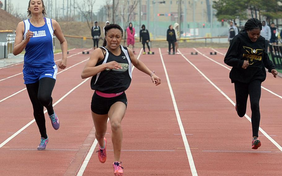 Humphreys' Taliyah Calloway leads the pack toward the finish in the girls 100 dash during Saturday's truncated Korea track and field meet at Humphreys' Blackhawks Stadium. Calloway won in 13.94 seconds on the stop watch.