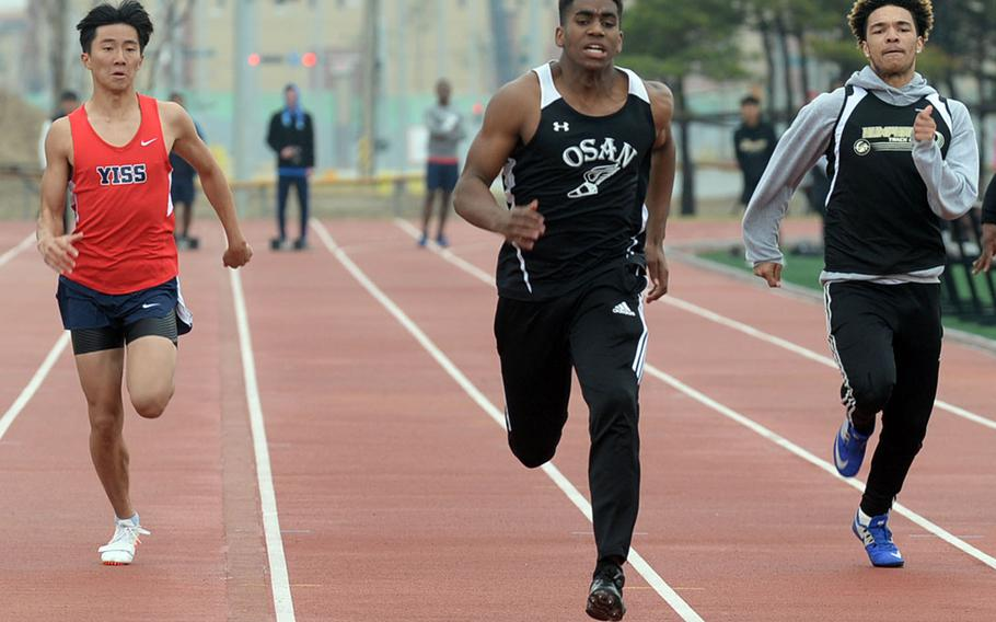 Osan's Cameron Jones heads toward the finish of the boys 100 dash during Saturday's truncated Korea track and field meet at Humphreys' Blackhawks Stadium. Jones won in 11.5 seconds on the stop watch.