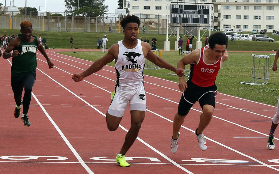 Kadena's Eric McCartercrosses the line first in the boys 100 during Saturday's Okinawa track and field meet at Kadena.