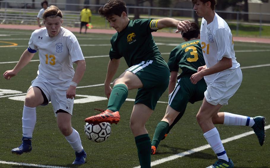 Robert D. Edgren's Joshua Hartley plays the ball against Yokota's Eli Newton and Renyck Robertson during Saturday's DODEA Japan boys soccer match, won by the Panthers 3-0.