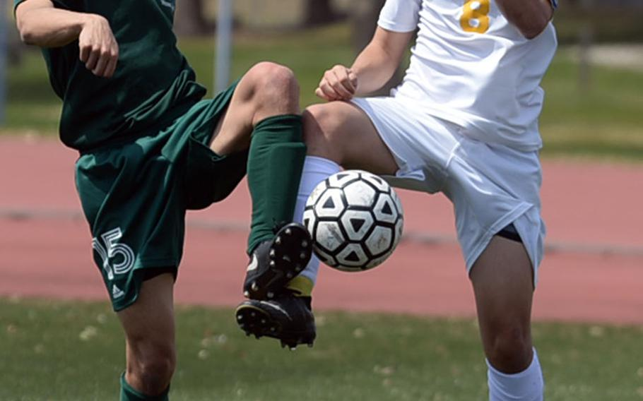 Yokota's James Fearney and Robert D. Edgren's Dakota Padilla try to settle the ball during Saturday's DODEA-Japan boys soccer match, won by the Panthers 3-0.