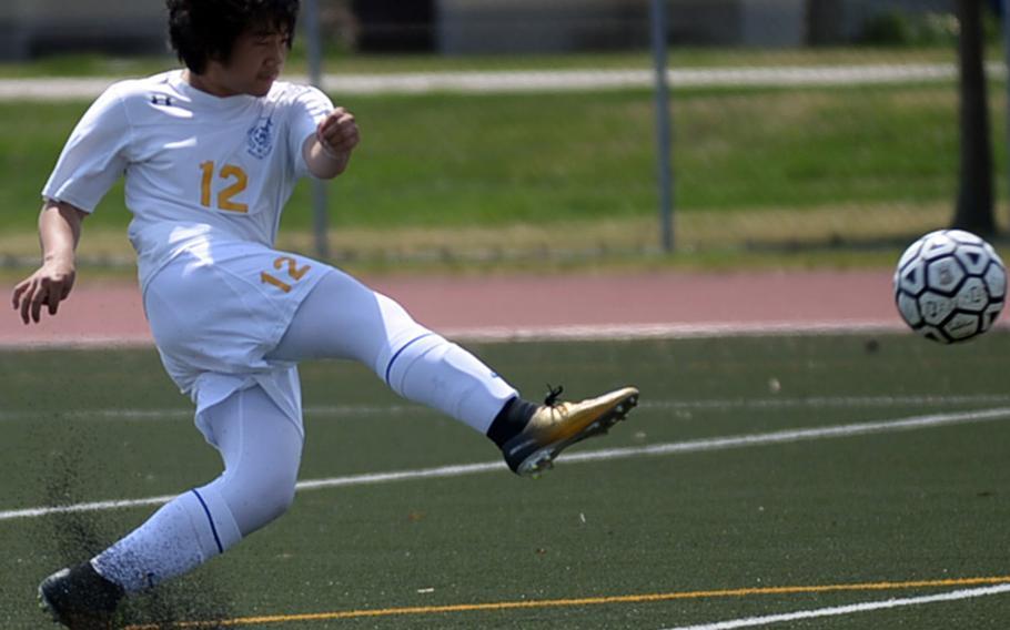 Yokota's Ken Baarde fires a shot against Robert D. Edgren during Saturday's DODEA Japan boys soccer match, won by the Panthers 3-0.