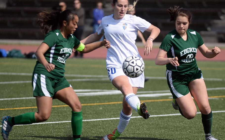 Yokota's Sarah Schultz shoots between Robert D. Edgren defenders Sopheary Soun and Kayla Ashby during Saturday's DODEA-Japan girls soccer match, won by the Panthers 8-0.