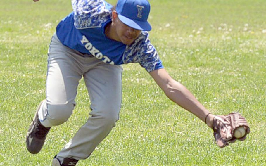 Yokota's Richard Stowe lunges and catches a line drive against Zama during Saturday's DODEA-Japan baseball tournament game. Yokota won 5-2 and finished the tournament 4-0, winning it for the third straight year.