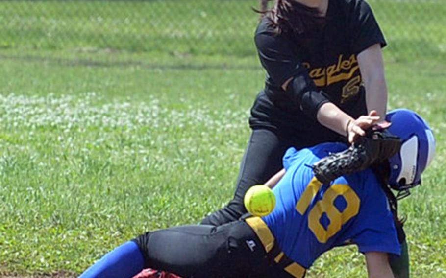 Yokota's Annalise Rodriguez slides safely into second base as Robert D. Edgren shortstop Veronica Crawford can't find the handle on the ball during Saturday's DODEA-Japan softball tournament finals. The Eagles rallied past the Panthers 13-12 to win the tournament for the first time in school history.