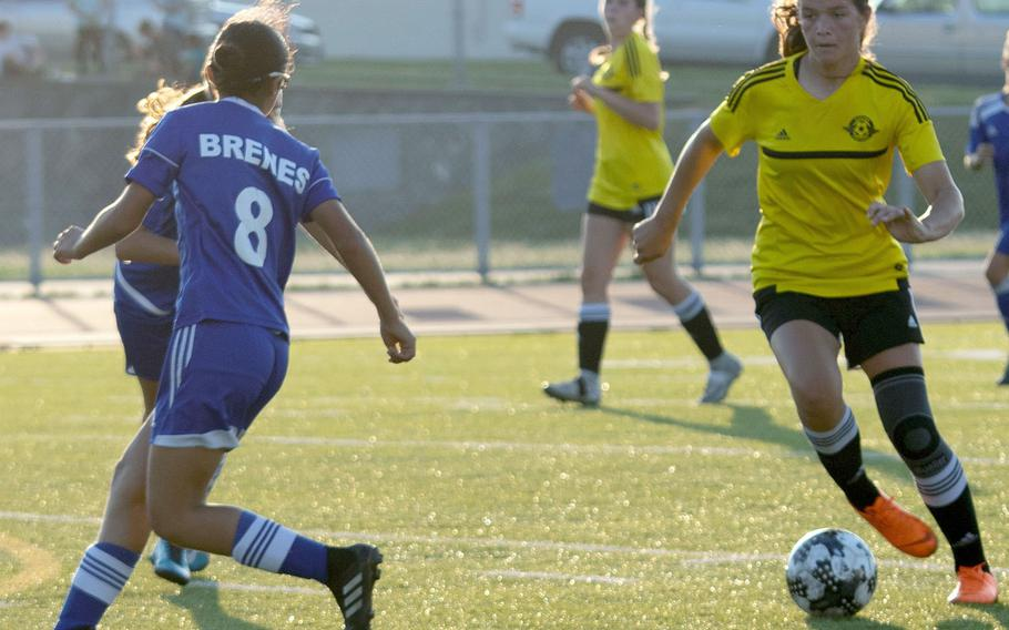 Kadena's Megan Kirby, right, dribbles upfield against Okinawa Diplomats FC during Wednesday's girls soccer match, won by the Panthers 7-0.