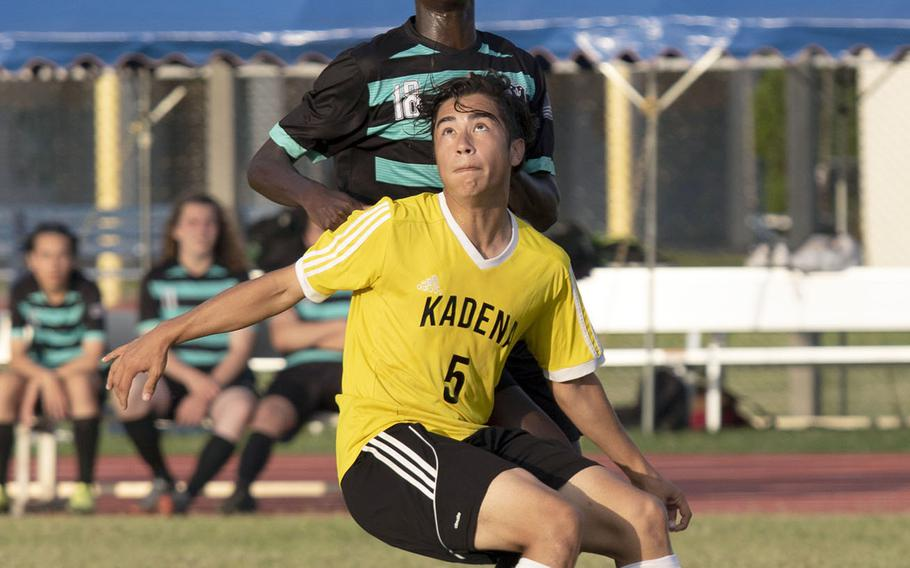 Nile C. Kinnick's Akimanzi Siibo and Kadena's Eric Fletcher ready to head the ball during Monday's round-robin play in the Far East Division I boys soccer tournament. The teams played to a 1-1 draw.