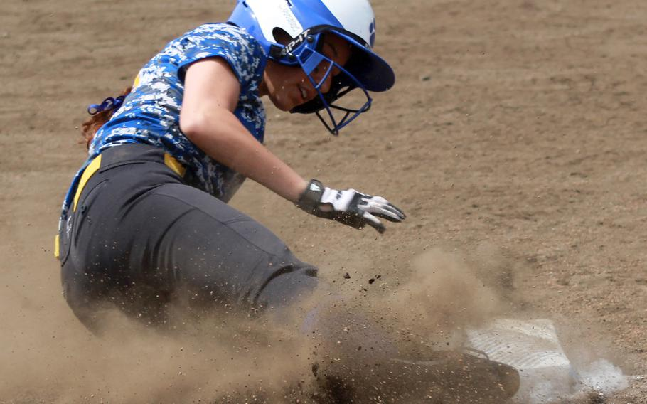 Yokota's Annalise Rodriquez slides into third base during Monday's round-robin play in the Far East Division II softball tournament. Yokota went 2-0-1 and earned the No. 3 seed into the double-elimination playoffs.