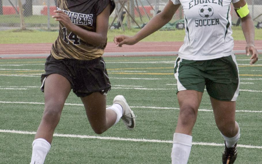 Humphreys' Hayden McMillan and Robert D. Edgren's Christina Taylor chase down the ball during Tuesday's playoff match in the Far East Division II girls soccer tournament. McMillan scored twice to lead the Blackhawks over the Eagles 2-0.