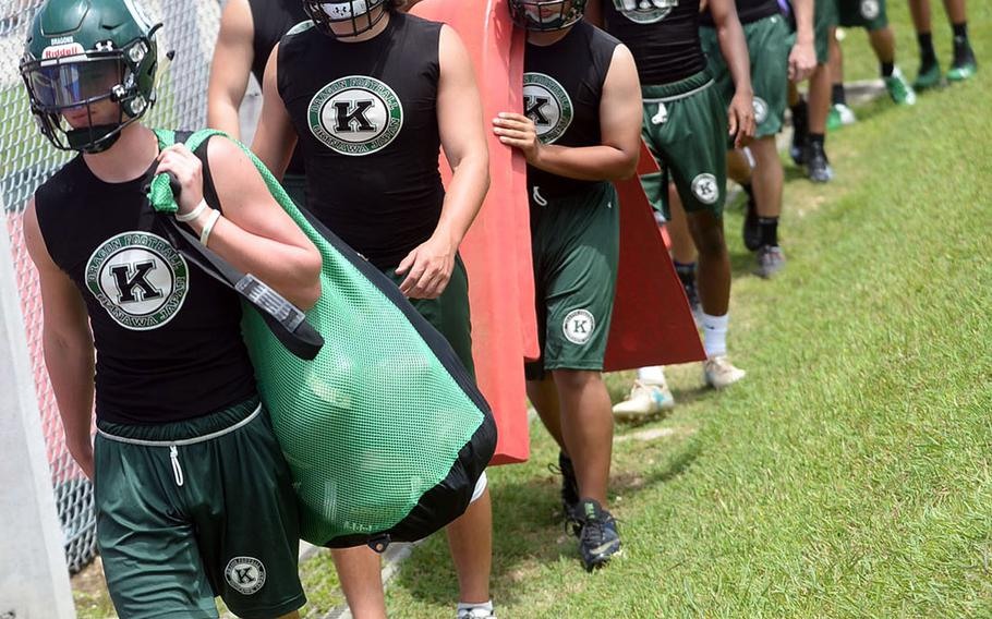 Kubasaki football players head out to the practice field on Monday, the opening day of official practices.