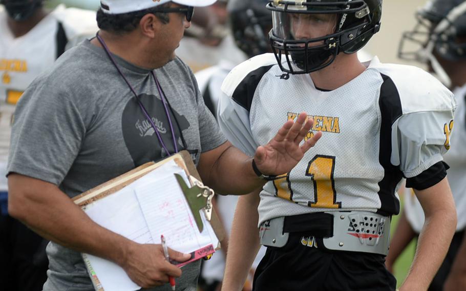 Coach Sergio Mendoza gives some pointers to his new quarterback, Wyatt Knopp.