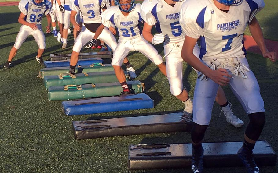 Seniors Eli Philliips and Ethan Gaume lead the way during a weave drill at Tuesday's Yokota practice.