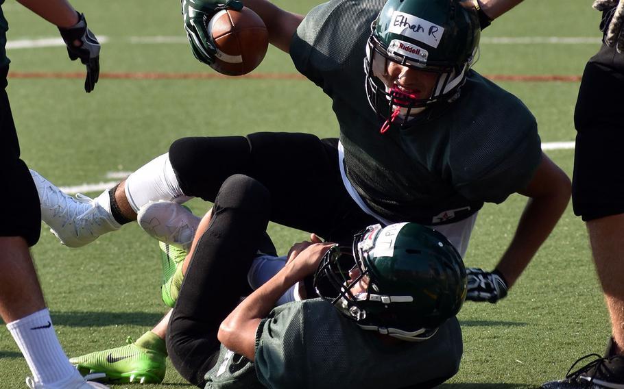 Daegu running back Ethan Rodriguez is taken down by defender Donald Thomas.