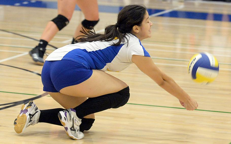 Yokota's Veronica Crawford dives to save a spike by Nile C. Kinnick. The Red Devils beat the Panthers in four sets.