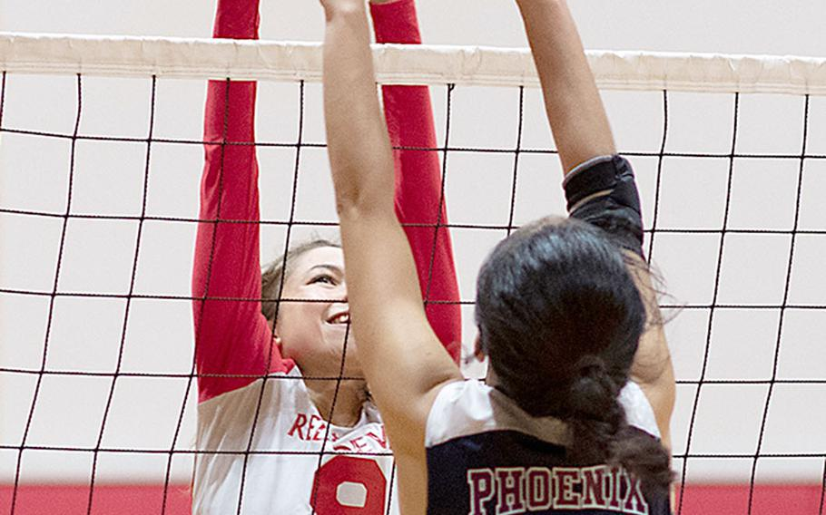 Nile C. Kinnick's Melissa Rose and Seisen International's Aimi Iwao battle at the net during Friday's rematch of last year's Far East Division I Tournament final. The Phoenix won this one also, 25-18, 25-23, 25-18 over the Red Devils.