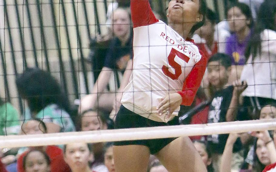 Nile C. Kinnick's Lynelle Adepoju rips a shot against Seisen during Friday's rematch of last year's Far East Division I tournament final. The Phoenix won this one also, 25-18, 25-23, 25-18.