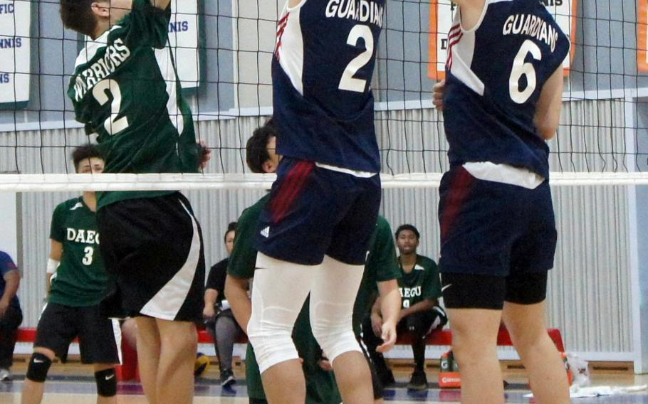Yongsan International-Seoul's Max Choi and Jacob Jeon battle Daegu's Aleiandro Jesus Miller for the ball during Saturday's Korea Blue boys volleyball match, won by the Guardians in three sets.