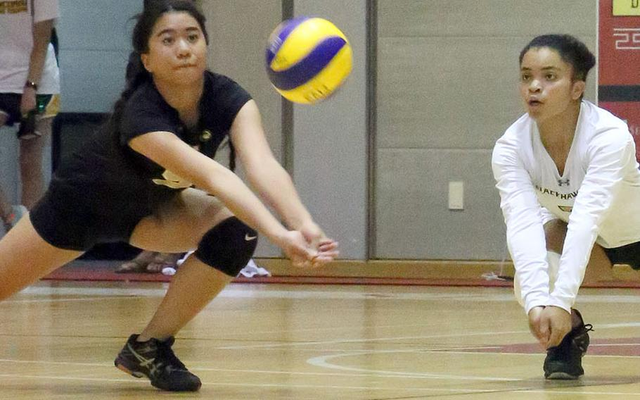 Julianna Visico and Cleopatra Cody of Humphreys dive for the ball during Wednesday's three-set loss at Seoul Foreign.