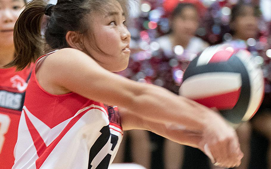 St. Maur's Renge Shirai bumps the ball against Nile C. Kinnick during Wednesday's three-set victory by the Red Devils over the Cougars.