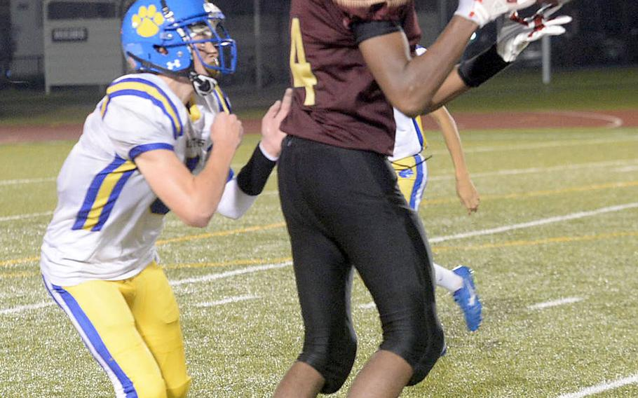 Matthew C. Perry's Micah Rupp catches a pass in front of Yokota's Ethan Gaume.