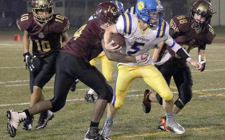 Yokota's Ethan Gaume drags Matthew C. Perry defenders Micah Rupp and Robert Rogers, with Roy Clayton in trail.