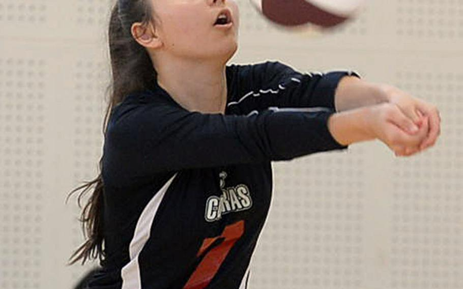 E.J. King's Miya O'Mara digs up a spike against Marist Brothers during Saturday's volleyball match. The Bulldogs beat the Cobras in five sets.