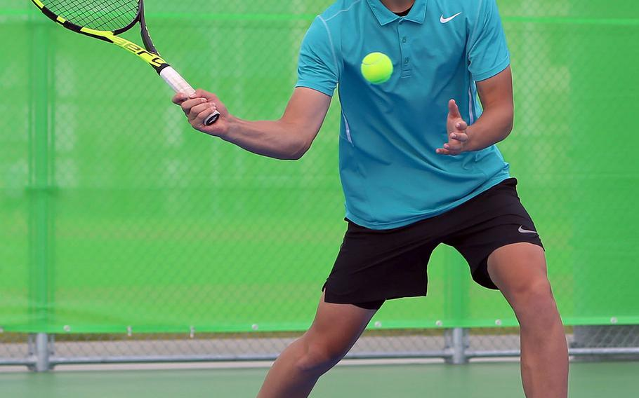 Matthew C. Perry's Kai Lange smacks a forehand return during his 6-0 singles win Saturday over Kadena's Joe Lamoureux in an inter-district match.