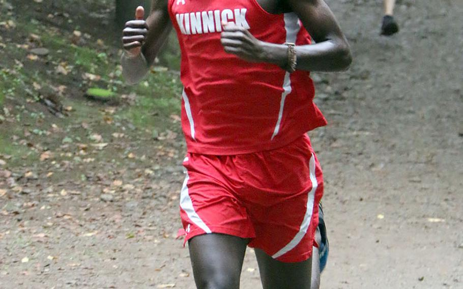 Nile C. Kinnick's Akimanzi Siibo took first place in Saturday's Kanto Plain boys cross country race at Tama Hills Recreation Center.