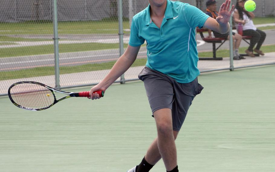 Matthew C. Perry's Noah Saperstein hits a forehand return during his 6-4 singles loss Saturday to Kadena's Sam Stebbins  in an inter-district singles match.