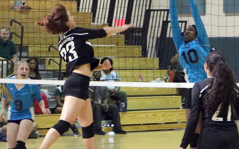Daegu's Katherine Johnson slams the winning point past Osan's Jolisea Barton-Green during Saturday's five-set win by the Warriors over the Cougars -- Daegu's first varsity girls volleyball victory in five seasons.