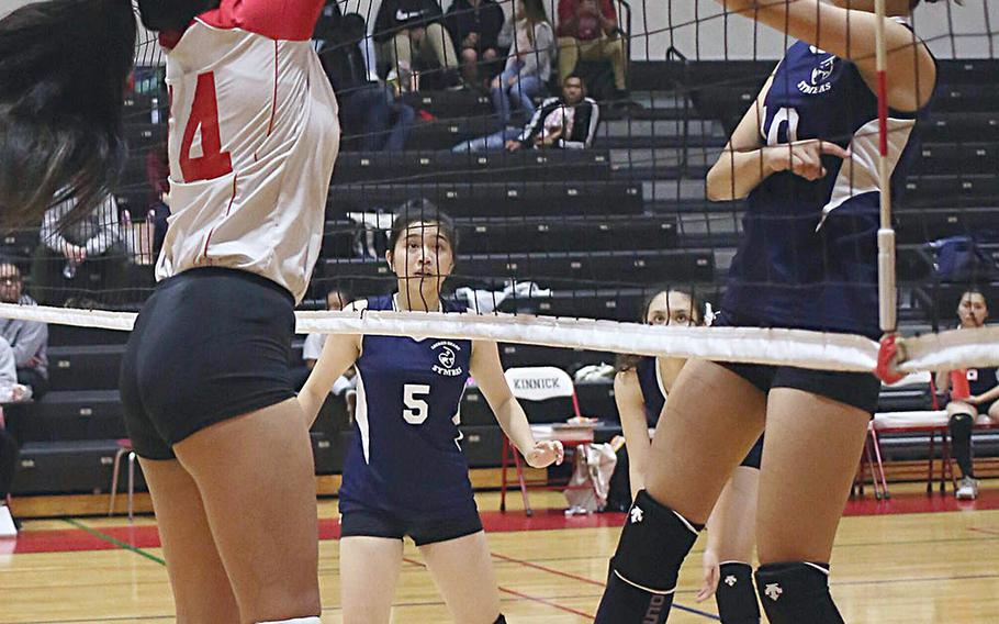 Sacred Heart's Karin Kosugi has a shot blocked by Nile C. Kinnick's Francine Gemeniano during Thursday's three-set win by the Red Devils over the Symbas.