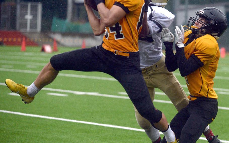American School In Japan's Tyler Cross grabs one of his two interceptions vs. Humphreys.