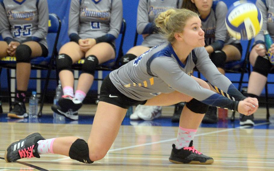 Yokota's Rorie Jenkins digs up a serve from Sacred Heart during Monday's five-set win by the Panthers over the Symbas.