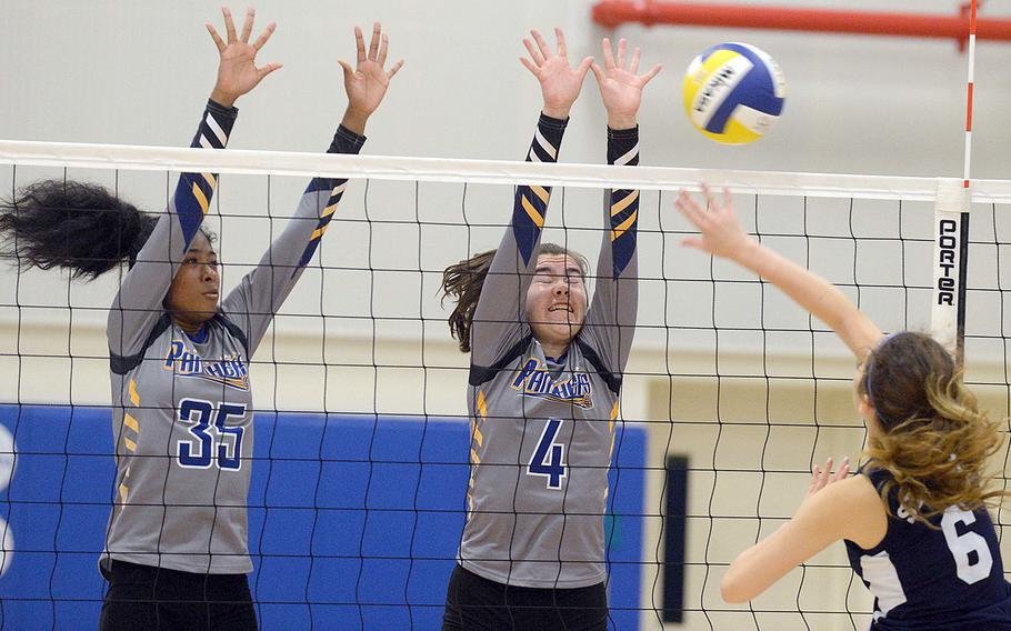 Sacred Heart's Mia Warita hammers a spike into a double block by Yokota's Alexis Smalls and Caleigh Garcia during Monday's five-set win by the Panthers over the Symbas.