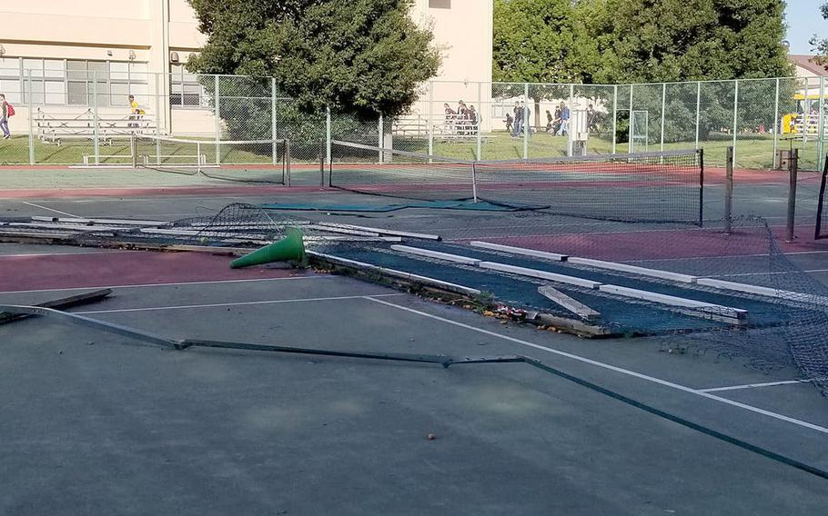 Yokota High School's tennis court fencing and court border separation wood took a pounding Sunday from Typhoon Trami and the courts are no longer playable, according to coach Tommy Palmer and athletics director Tim Pujol.