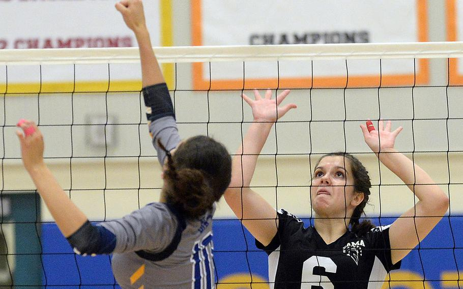 Yokota's Adrianna Diaz and Zama's Amelia Young battle at the net for the ball during Tuesday's three-set win by the Trojans over the Panthers.