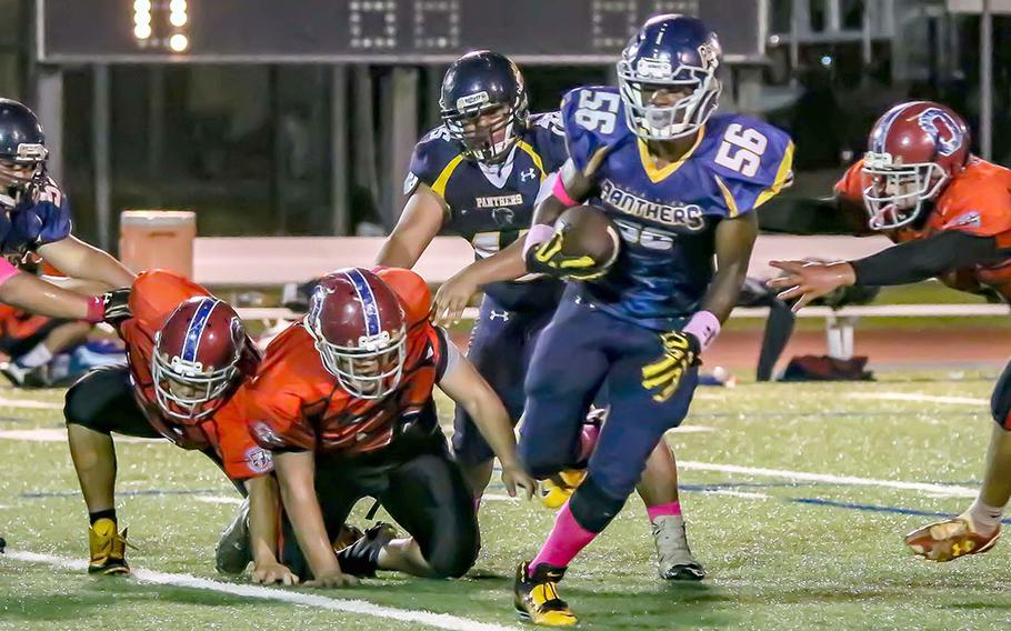 Guam High's Jeylyn Dowdell leaves a sea of humanity in his wake.