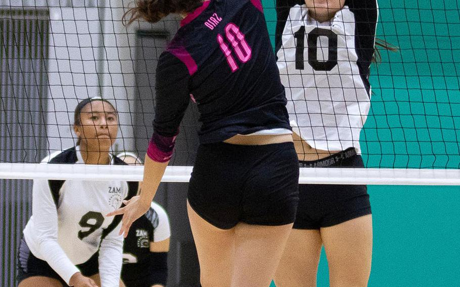 Yokota's Adrianna Diaz and Zama's Leah Sakamoto-Flack battle at the net during the Panthers' two-set win Friday in the 4th American School In Japan YUJO Tournament.