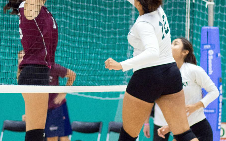 Seisen's Lilu Vandercamme tries to block Kubasaki's Roselyn Johnson's shot during Friday's two-set win by the Dragons in the 4th American School In Japan YUJO Tournament.